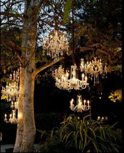 crystal chandeliers over the ceremony space are a great glam idea