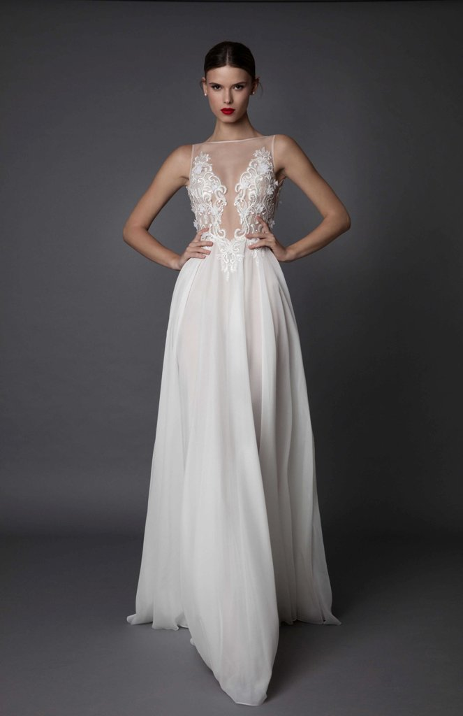 illusion plunging neckline wedding dress with a lace bodice and a flowy silk skirt