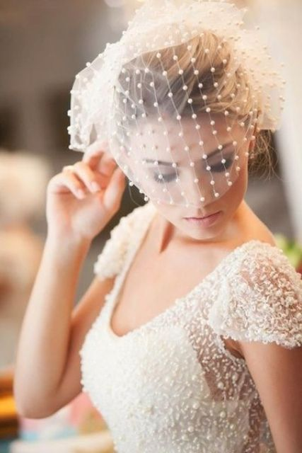 pearl birdcage veil is a statement
