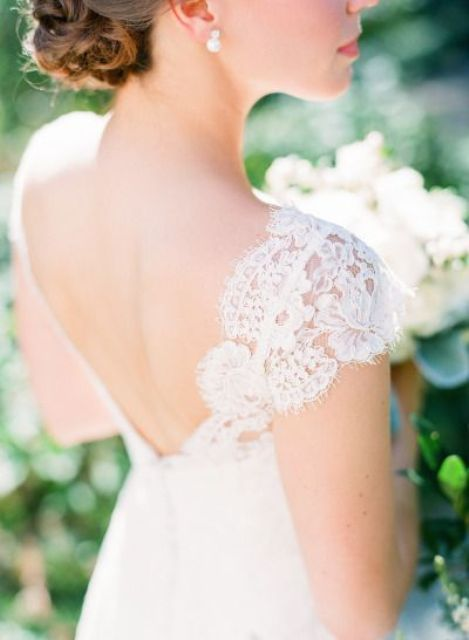 simple lace cap sleeves and an open back for a romantic feel