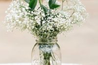 09 white roses, baby's breath in a jar on a stack of vintage books