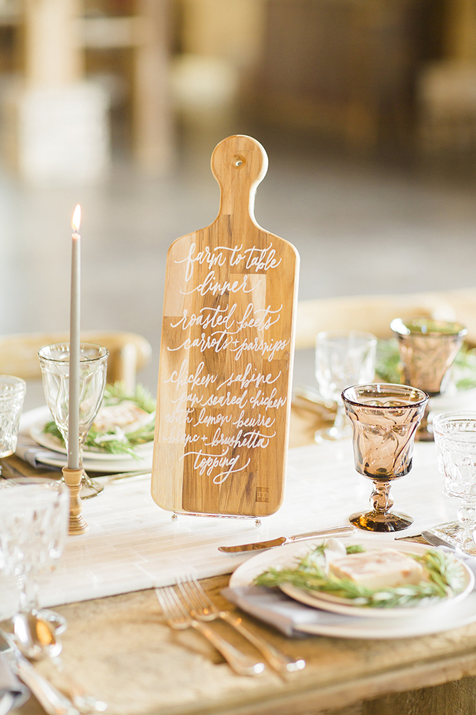 Cutting boards for showing menus is a great idea for a rustic celebration