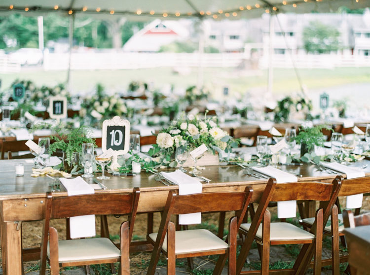 The tablescapes were simple and fresh, with a lot of greenery and neutral blooms and chalkboard table numbers