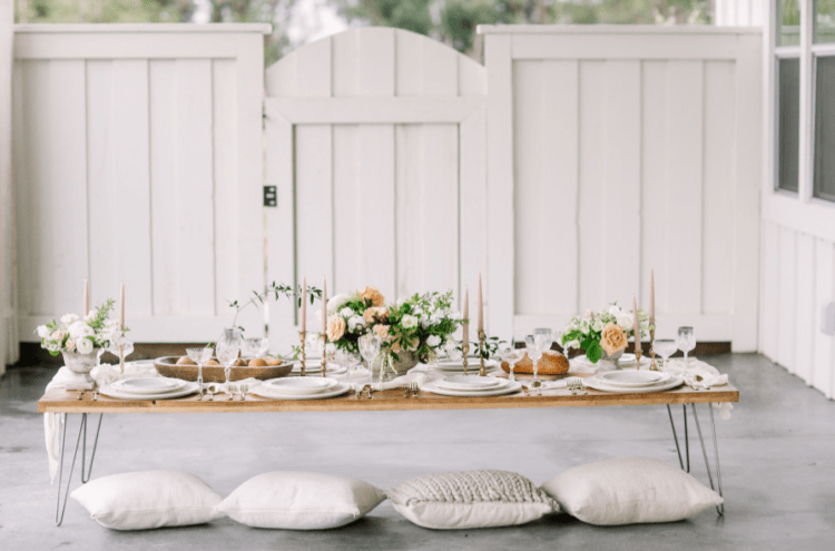 This is a boho variant of the table setting, low with pillows to sit on the floor