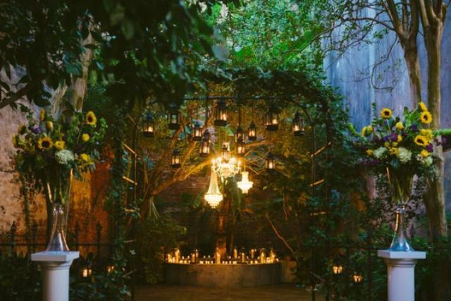 crystal chandeliers and lanterns hanging and candles