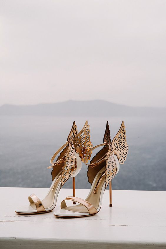 metallic gold stiletto wedding sandals with butterfly wings on the back