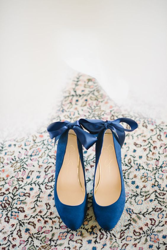 navy suede heels with ribbon bows on the back