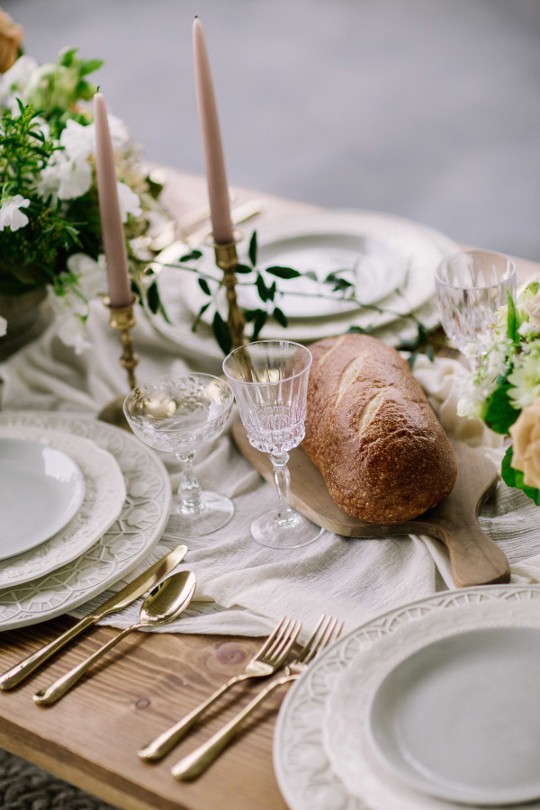 This is a rustic table setting, where food becomes a part of the decor