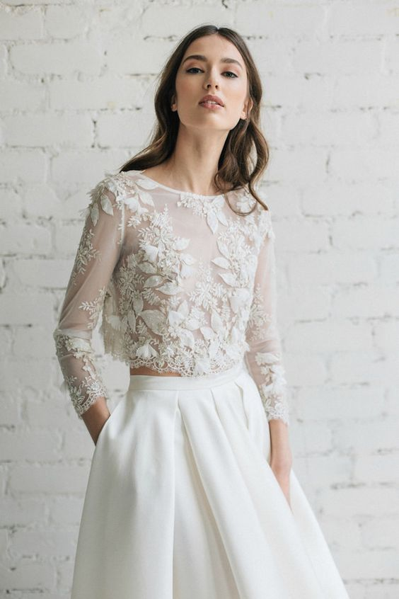 a plain ivory skirt with pleats and a floral applique ctop top with sleeves