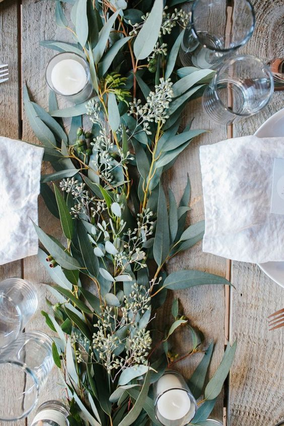eucalyptus table runner with candles for a rustic tablescape