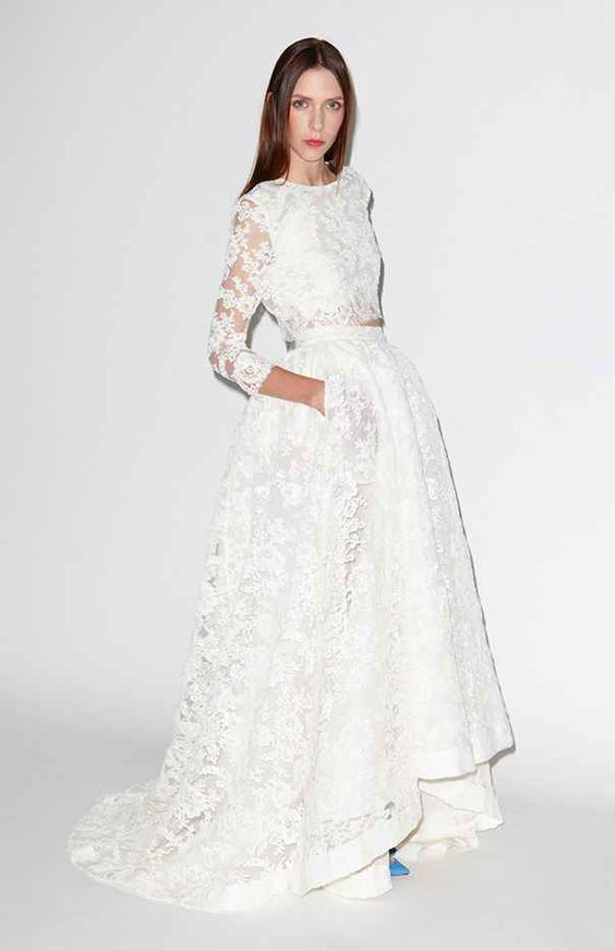 white lace applique bridal separate with half sleeves and a high low skirt with pockets