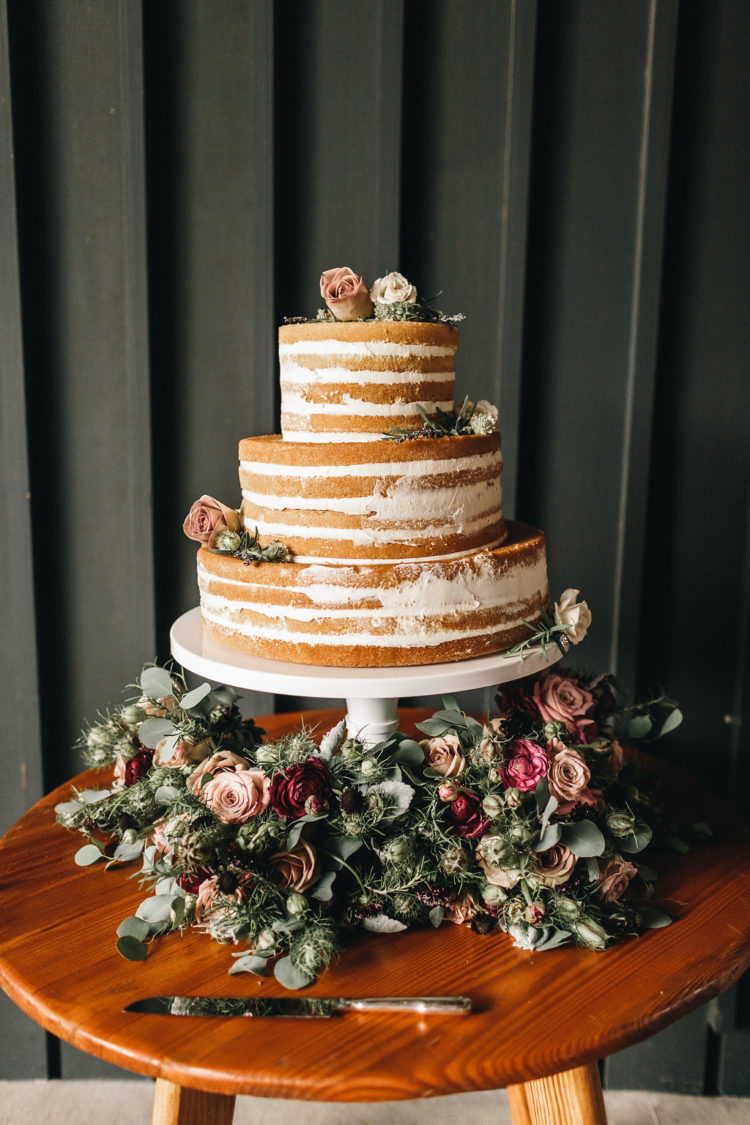The naked wedding cake was almond and was served with lots of greenery and fresh blooms