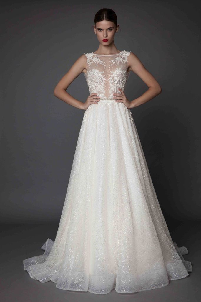 a white sparkling wedding dress with an illusion bodice and lace appliques