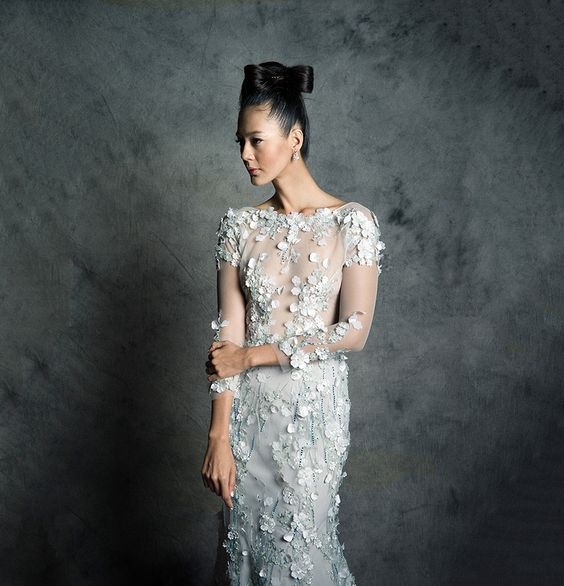 ice blue sleeved wedding gown with illusion neckline and cascading floral appliques