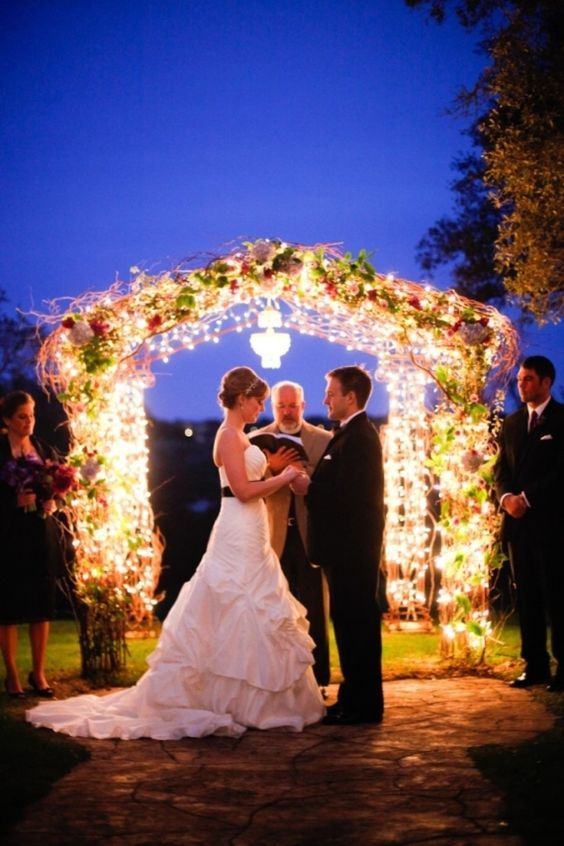super shiny wedding arch with flowers will illuminate the space the best way possible