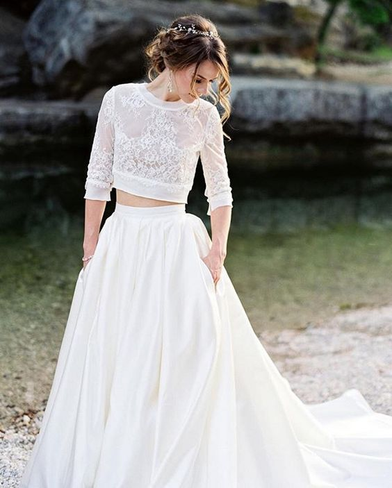 two piece wedding dress with a lace bodice with sleeves and a plain skirt with pockets