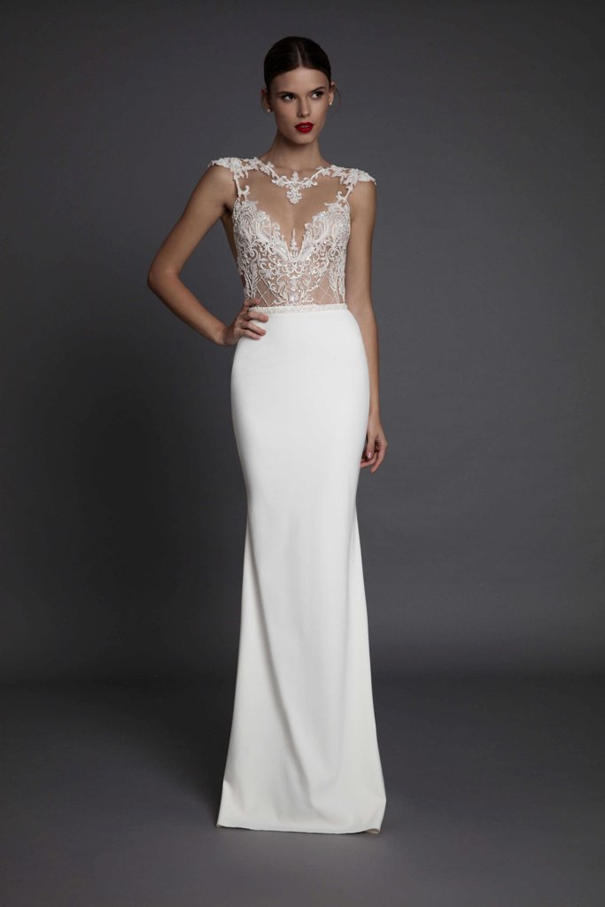 an illusion neckline weddign dress with a lace bodice and a plain skirt