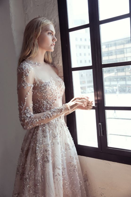 silver wedding dress with illusion sleeves and a bodice