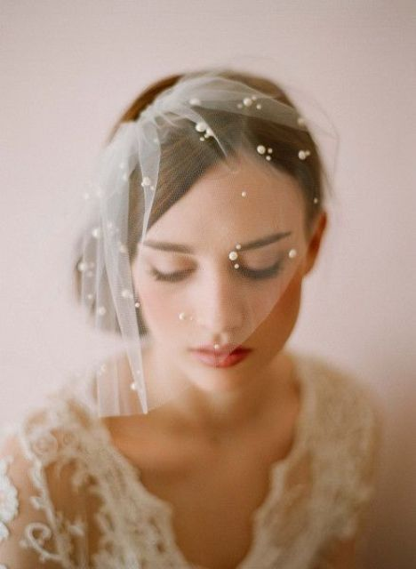 tiny subtle birdcage veil with some pearls
