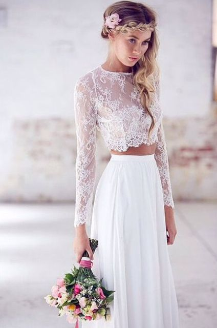 a plain skirt and a lace crop top with long sleeves