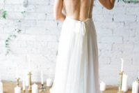 14 airy and flowy wedding gown with spaghetti straps and no back
