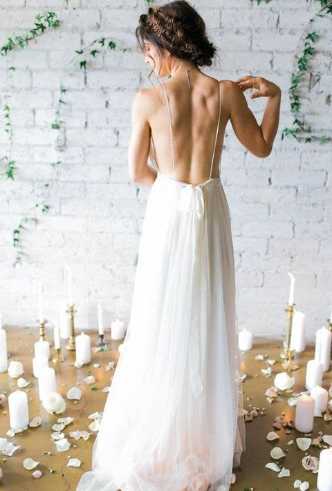 airy and flowy wedding gown with spaghetti straps and no back