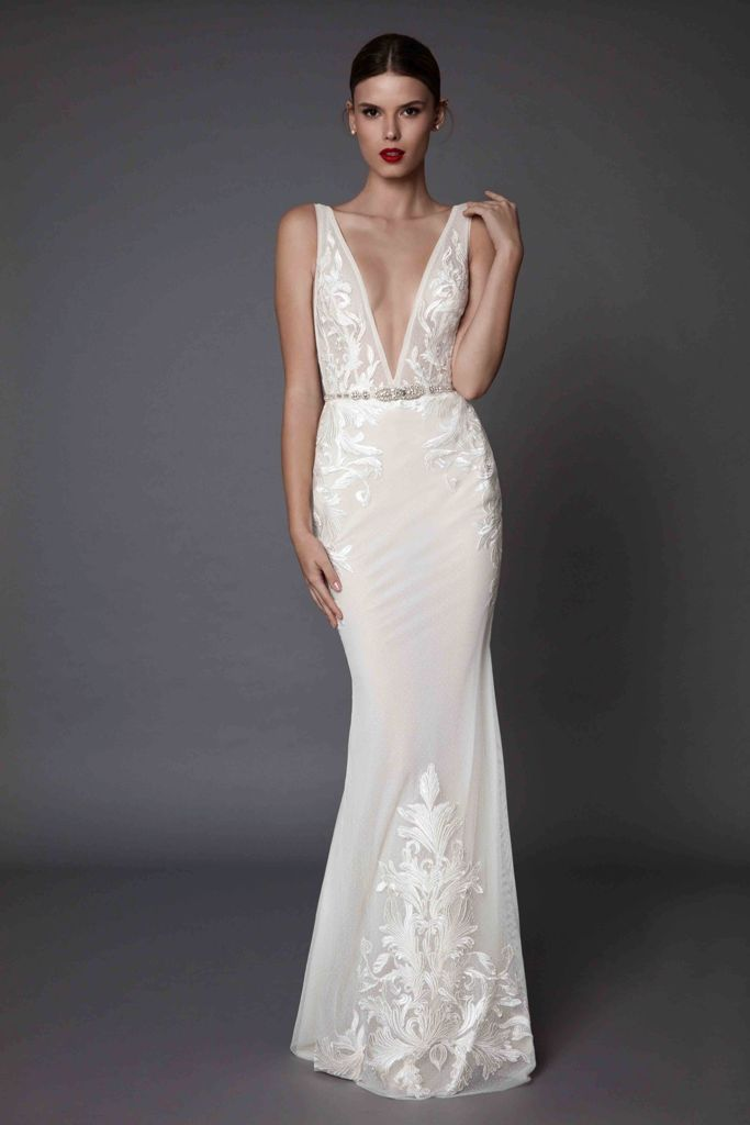 plunging neckline wedding dress with lace appliques and an embellished belt for an accent