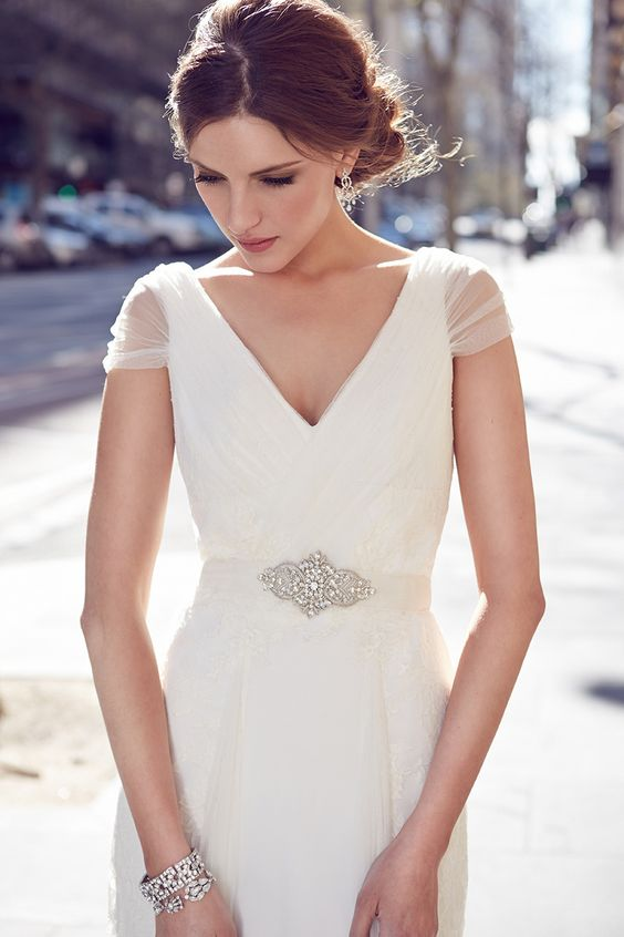 sheer tulle cap sleeves add interest to the dress