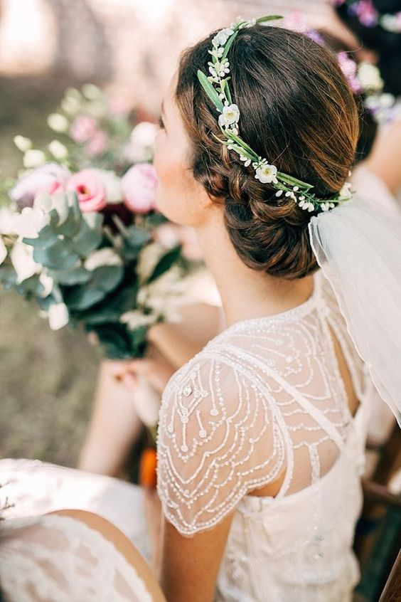 a simple, yet chic flower crown with small white blooms