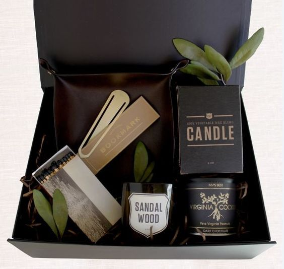 a stylish black box with a candle, matches, a bookmarks and a catch-all bowl