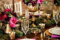 15 burgundy and hot pink centerpieces in gold vases create lush decor