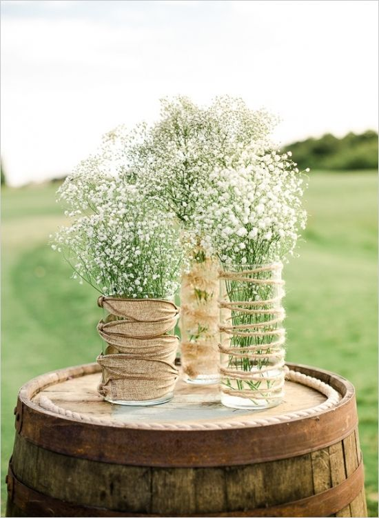 glass vases wrapped with twine and burlap and baby's breath