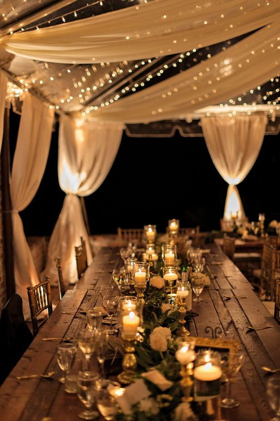 illuminate your reception with candles and string lights over it for a romantic feel