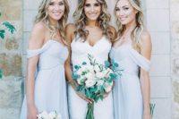 15 powder blue off the shoulder flowy bridesmaids' dresses and a bride in a spaghetti strap wedding dress with a V neckline