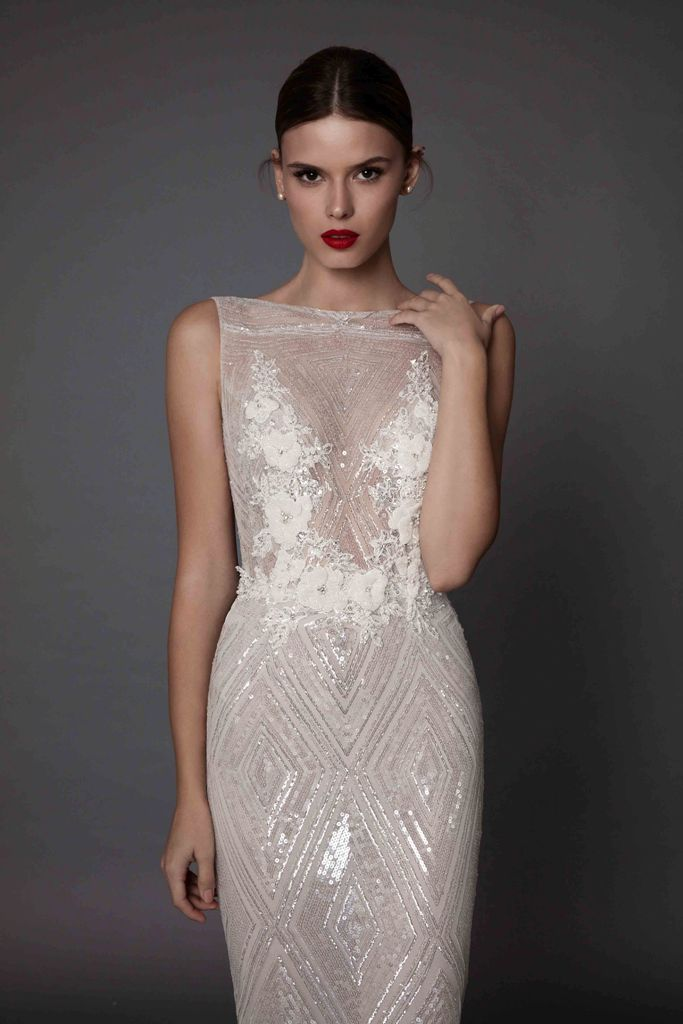 sparkling sleeveless wedding dress with a geometric pattern and lace floral appliques