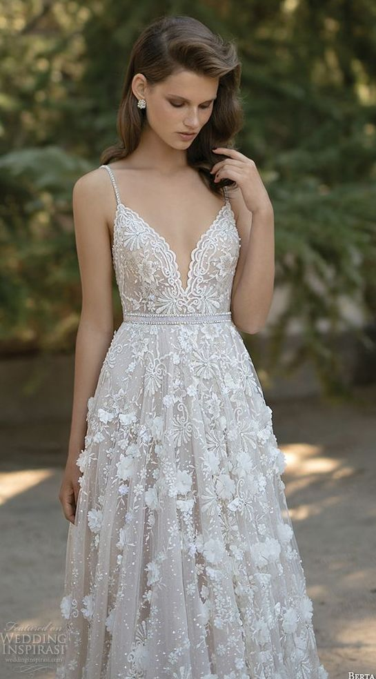 A line  wedding dress with spagetti straps,a sweetheart neckline and floral appliques
