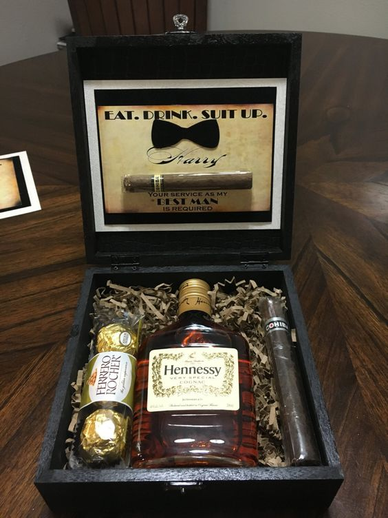 a cool box with cigars, Hennessy and Ferrero Rocher to spoil your friend
