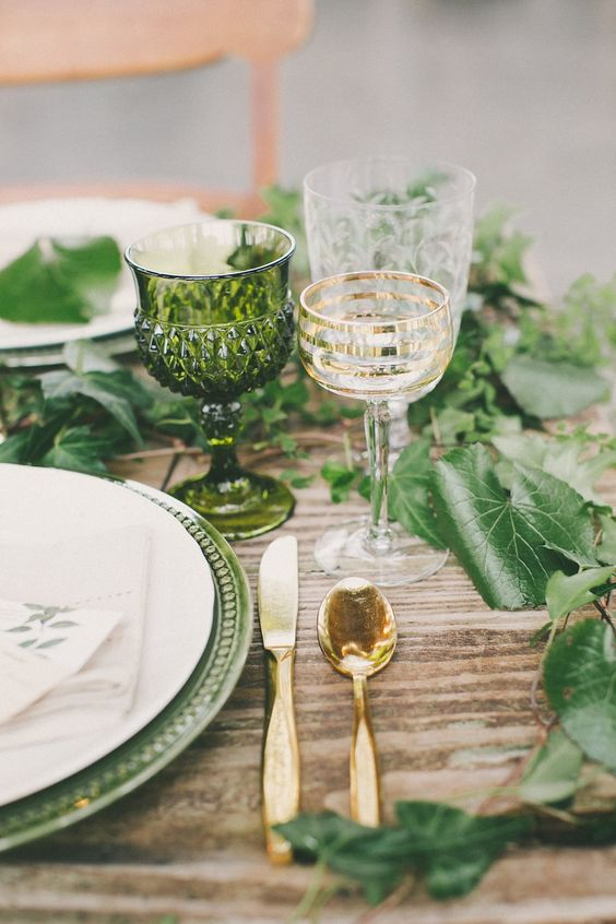 interwine each place setting with fresh leaves, add green platters and glasses to echo