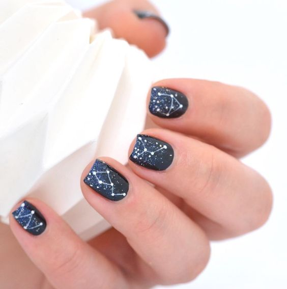 navy and black wedding nails with blue glitter and constellations