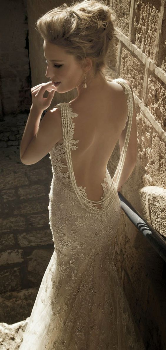 strands of pearls to accentuate the open back of the dress