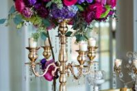 16 super bold floral centerpiece with fuchsia, purple and violet blooms and bold greenery