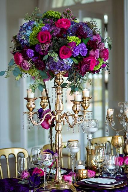super bold floral centerpiece with fuchsia, purple and violet blooms and bold greenery