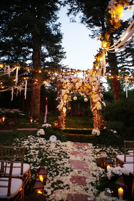 bulbs incorporated into the decor and lanterns to line up the aisle