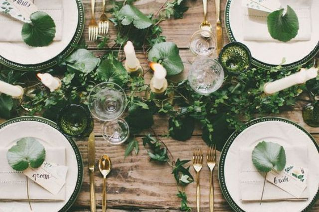 greenery table garland, leaves on the place settings and green glasses