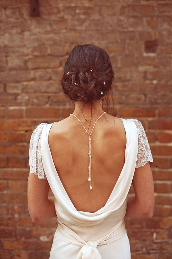 pearl drop back necklace highlights the open back
