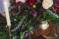 17 purple, hot red bloom centerpiece with textural greenery