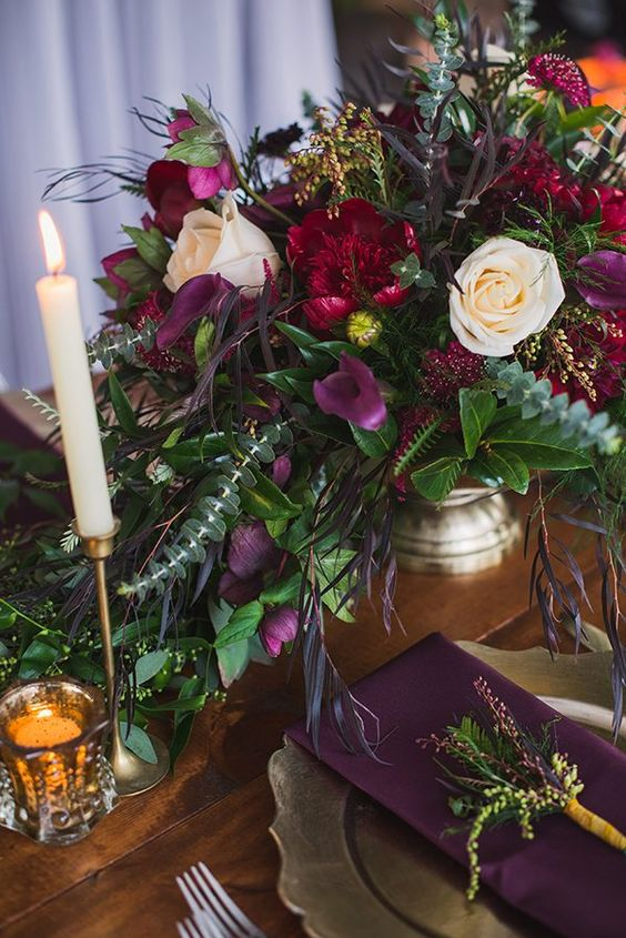 purple, hot red bloom centerpiece with textural greenery
