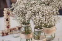 17 several jars wrapped with burlap and with baby's breath for a beautiful table