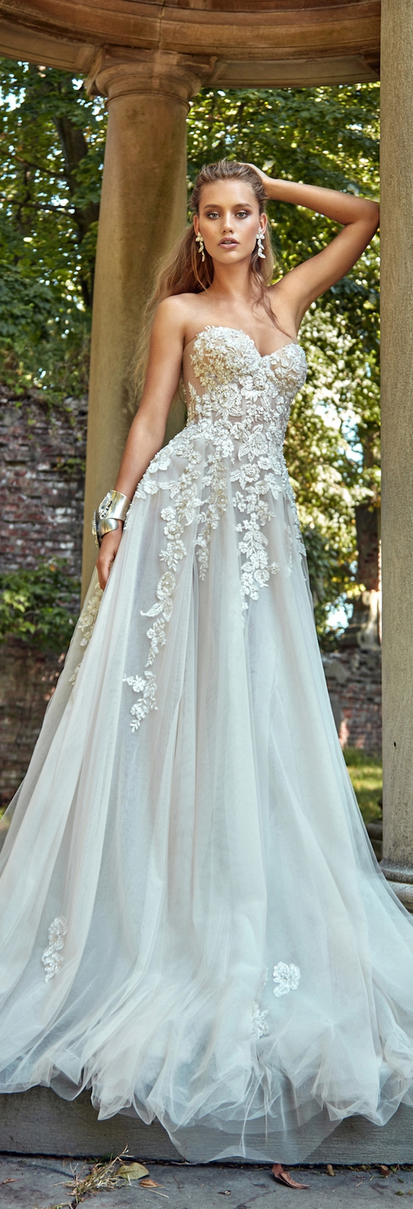strapless floral lace applique wedidng dress with a flowy skirt