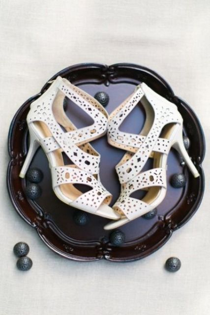 white laser cut sandals look chic and bold